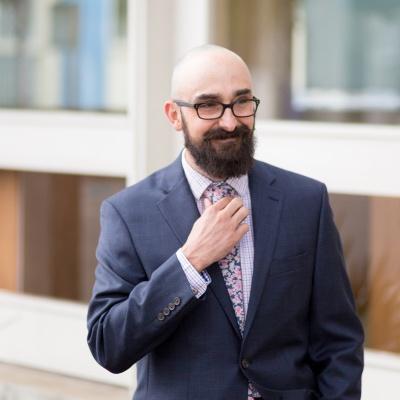 Garrett Perks, EvenVision Founder adjusts tie